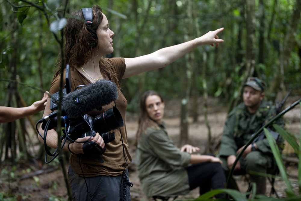 "Arianna LaPenne on VICELAND shoot for the show ""WOMAN with Gloria Steinem"", filming with the FARC guerillas in the Colombian jungle. (Photographer Carlos Villalon)"