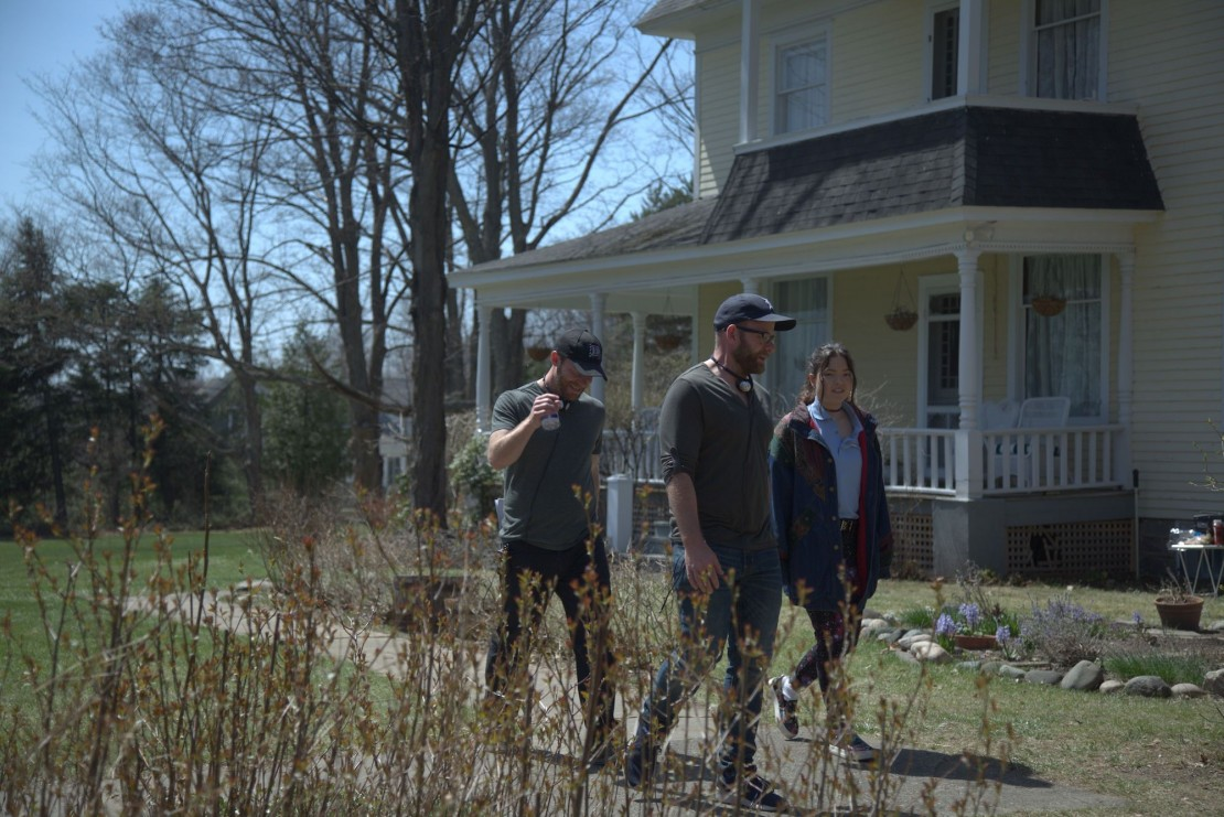 """Directors Brett and Drew Pierce, and Piper Curda as """"Mallory"""" on set of Brett and Drew Pierce's THE WRETCHED. Courtesy of IFC Midnight. An IFC Midnight Release."""