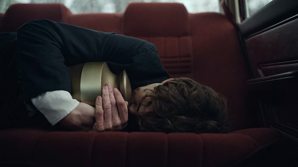 James (Alex Lawther) clutching his father's ashes in 'The End of the F***ing World'