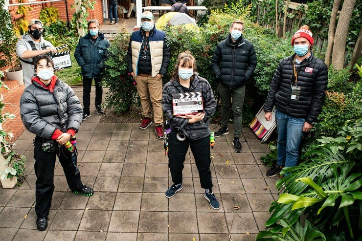 Masked production team is Filmmaking in the time of Corona.