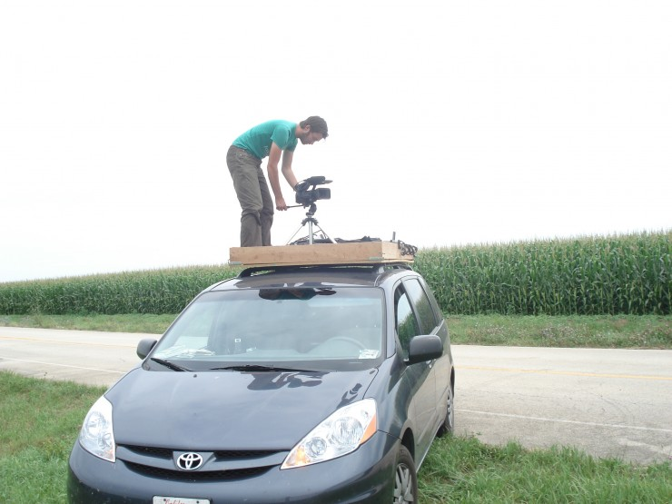 Mike Ambs on set before permanently securing the crane to the roof of the production van.