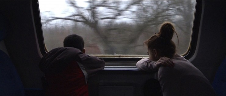 Toto and Andrea on a train