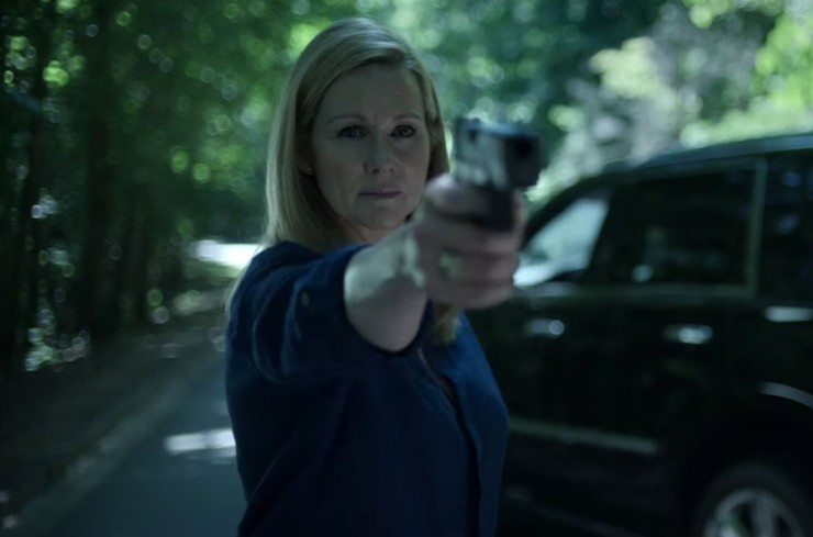 Stilll from OZARK Season 3, Laura Linney pointing a gun toward the camera