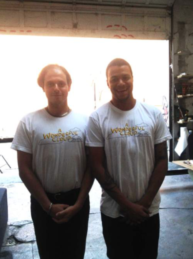 Eugene and the film's Executive Producer, Christian Rosa, posing like Oscar statues in their Cloud shirts.