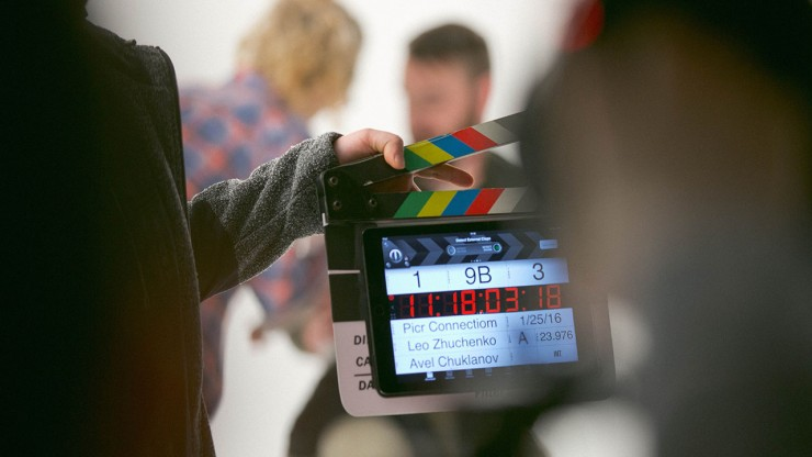 Clapping slate on set
