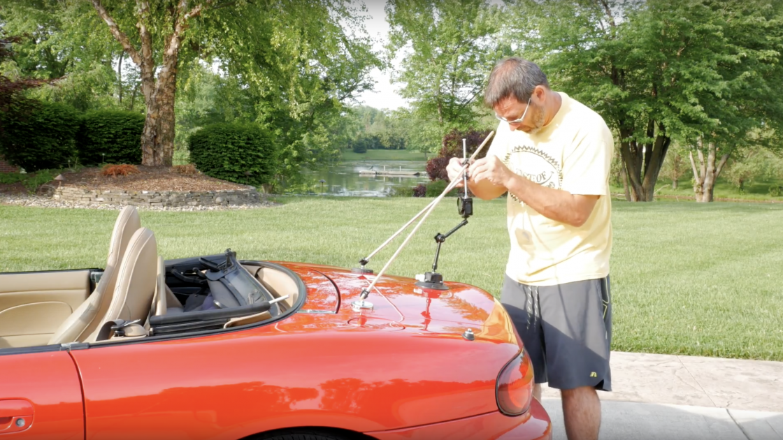 Learn How to Use Magnets, Gear Ties, and Suction Cups to Create This DIY Car Mount