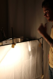 Book light created by bouncing light off cream-colored board and back through diffusion