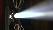 stock-footage-film-projector-dolly-shot-slow-motion-close